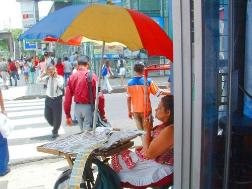 -- costa san seller sales rica jose shade umbrella street woman tickets vendor