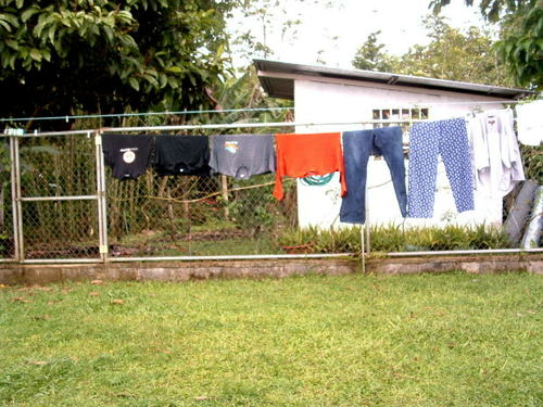 -- white laundry clothes costa rica wear jeans wash backyard gate tshirt apparel solar dryer