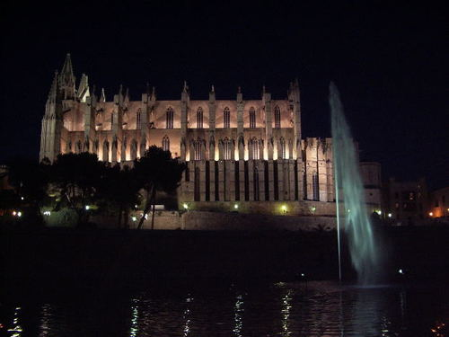 -- city history port cathedral mallorca embankment night turret buttress palma tower spain